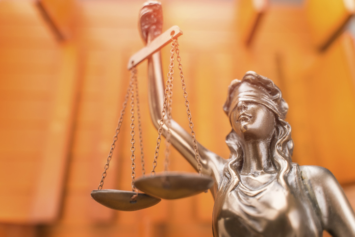 Statue of lady justice blindfolded, holding scales